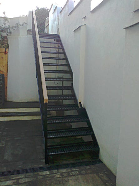 metal staircase with hardwood handrail
